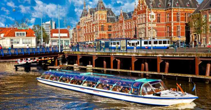 Amsterdam Pass Review - picture of boat in canal with buildlings in background
