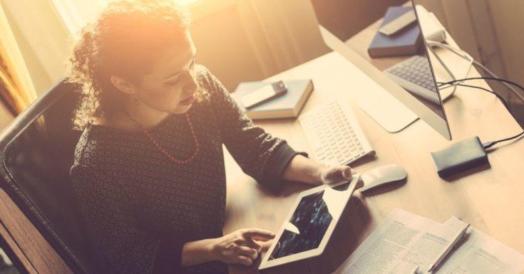 Mint vs Quicken - woman working at desk