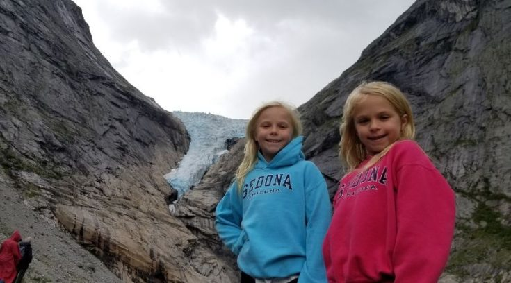 Photo of two girls in front of a glacier