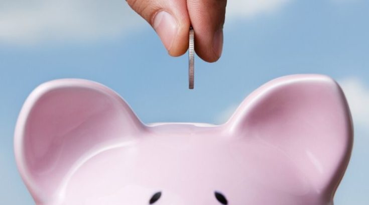 residual income - image of putting money in piggy bank